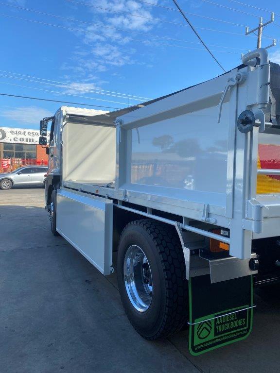 Hino with custom drop side truck body